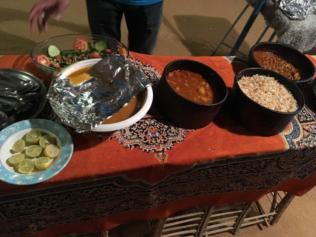 Nubian dinner with salad, vegetable stew, potato stew, rice