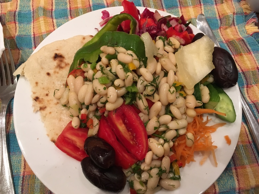 A vegan lunch example from the hotel buffet with beans, vegetables, dates, salad