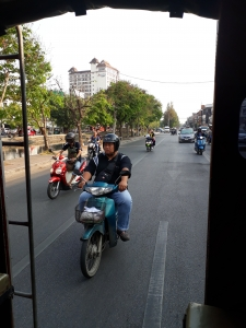 East side of Chang Mia's circular moat road. View of mopeds taken from Songtaew bahtbus