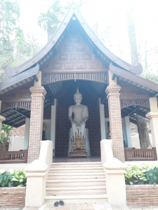 Temple at Wat Pha Lat with white Buddah statue