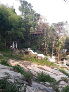Shot showing part of Wat Pha Lat compex buried in the jungle